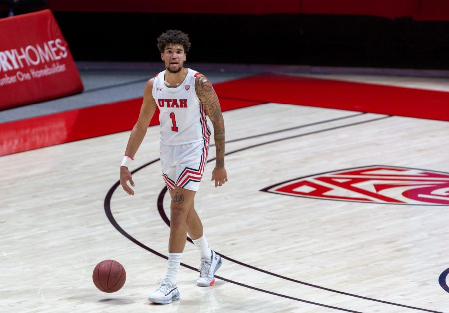 University of Utah men's basketball player, Timmy Allen (#1) dribbles the ball in the Utes' win against Utah Valley on Dec. 15, 2020 in the Jon M. Huntsman Center in Salt Lake City. (Photo by Jack Gambassi | The Daily Utah Chronicle)
