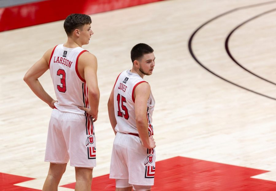 University of Utah mens basketball players Pelle Larsson (#3) and Rylan Jones (#15) stand as their teammate takes free-throws in the Utes win against Utah Valley on Dec. 15, 2020 in the Jon M. Huntsman Center in Salt Lake City. (Photo by Jack Gambassi | The Daily Utah Chronicle)