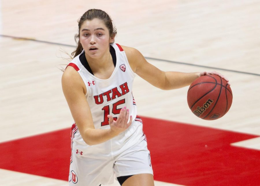 University of Utah women's basketball player, Kemery Martin (#15), looks for her teammate to change position in the game against the University of Arizona in the Jon M. Huntsman center in Salt Lake City on Dec. 20, 2020. (Photo by Jack Gambassi | The Daily Utah Chronicle)
