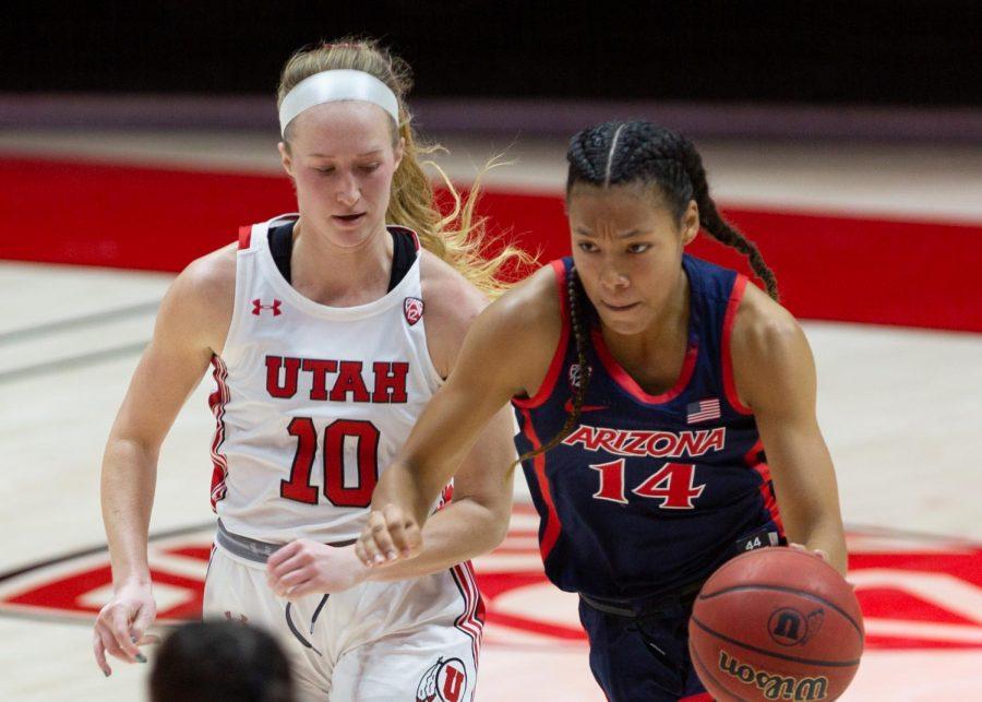 University of Utah women's basketball player, Dru Gylten (#10), runs alongside an opponent in the game against the University of Arizona in the Jon M. Huntsman center in Salt Lake City on Dec. 20, 2020. (Photo by Jack Gambassi | The Daily Utah Chronicle)