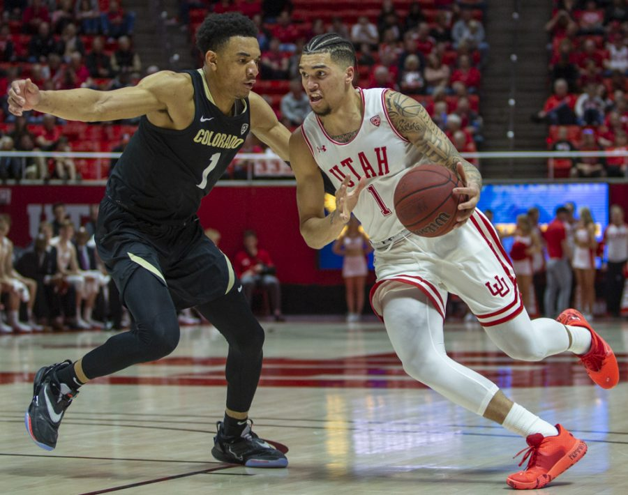 University of Utah sophomore forward Timmy Allen (1) drives by Colorado junior forward Tyler Bey (1) during an NCAA Basketball game vs. the Colorado Buffaloes at the Jon M. Huntsman Center in Salt Lake City, Utah on Saturday, March 7, 2020. (Photo by Jalen Pace | The Daily Utah Chronicle)