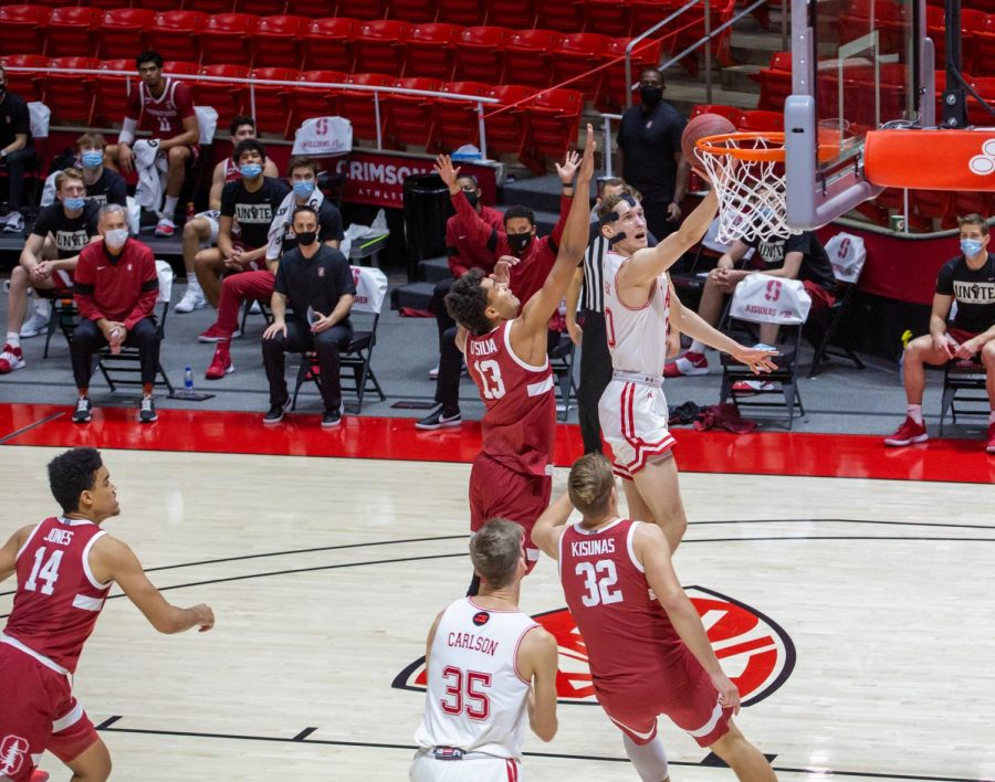 University of Utah sophomore forward Mikael Jantunen (20) goes for a layup during an NCAA Basketball game vs. the Stanford Cardinals at the Jon M. Huntsman Center in Salt Lake City, Utah on Thursday, Jan. 14, 2021. (Photo by Kevin Cody | The Daily Utah Chronicle)