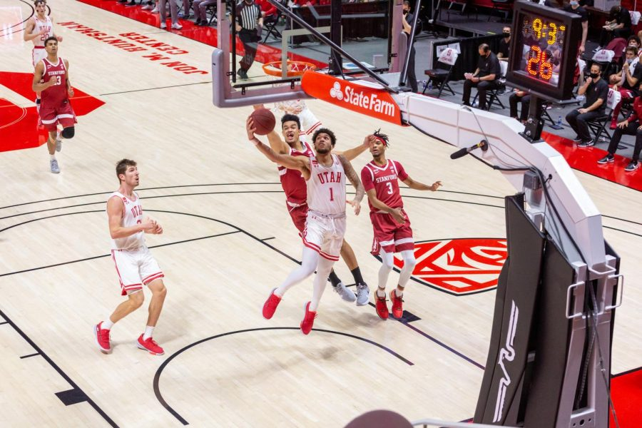 University of Utah junior forward Timmy Allen (1) goes for a layup during an NCAA Basketball game vs. the Stanford Cardinals at the Jon M. Huntsman Center in Salt Lake City, Utah on Thursday, Jan. 14, 2021. (Photo by Kevin Cody | The Daily Utah Chronicle)