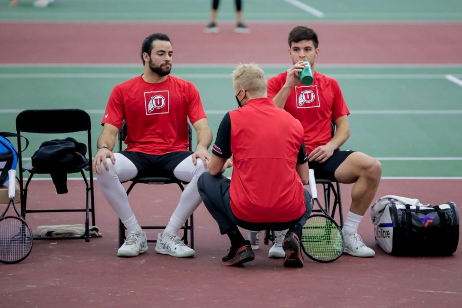 Utah Mens' Tennis players Gernonimo Busleiman and Franco Capalbo are coached by Associate Head Coach Sten Van Beurden during an NCAA dual meet against the Idaho State Bengals at the George Eccles Tennis Center in Salt Lake City on Jan 30, 2021 (Abu Asib | The Daily Utah Chronicle)