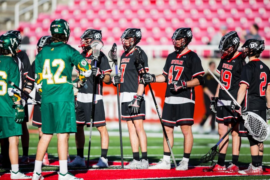 University of Utah's Men's Lacrosse team captains line up with Vermont's Men's Lacrosse team prior to the start of the game in an NCAA Men's Lacrosse game vs. Vermont at Rice-Eccles Stadium in Salt Lake City, UT on Friday February 01, 2019.(Photo by Curtis Lin | Daily Utah Chronicle)