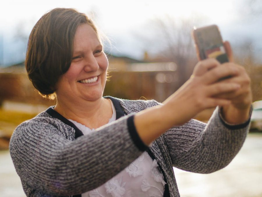 University of Utah Tik-Toking Professor Ruth Hackford-Peer demobnstrates a selflie video in front of her house in the Sugar House area, SLC, on January 29th, 2020. (Photo by Mark Draper | The Daily Utah Chronicle)