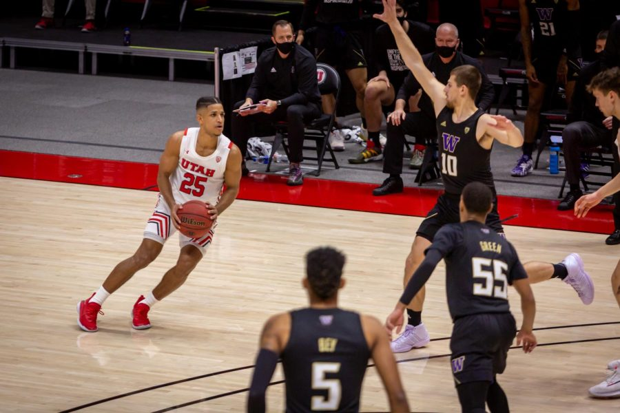 University of Utah Men's Basketball guard Alfonso Plummer (#25) attacks the University of Washington defense in the opening game between the two teams in the Jon M. Huntsman Center on U of U campus on Dec. 3, 2020. (Photo by Jack Gambassi | The Daily Utah Chronicle)