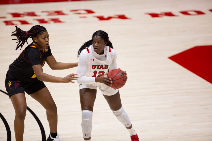 University of Utah women's basketball player, Lola Pendande (#12), looks for a pass in the game against Arizona State University in the Jon M. Huntsman center in Salt Lake City on Dec. 18, 2020. (Photo by Jack Gambassi | The Daily Utah Chronicle)