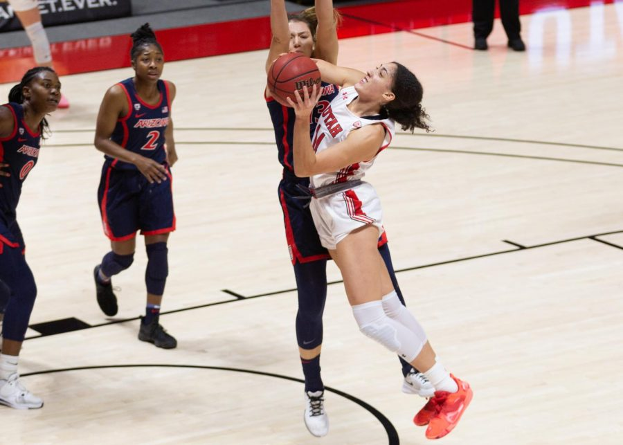 University of Utah women's basketball player, Niyah Becker (#14), drives to the rim in the game against the University of Arizona in the Jon M. Huntsman center in Salt Lake City on Dec. 20, 2020. (Photo by Jack Gambassi | The Daily Utah Chronicle)