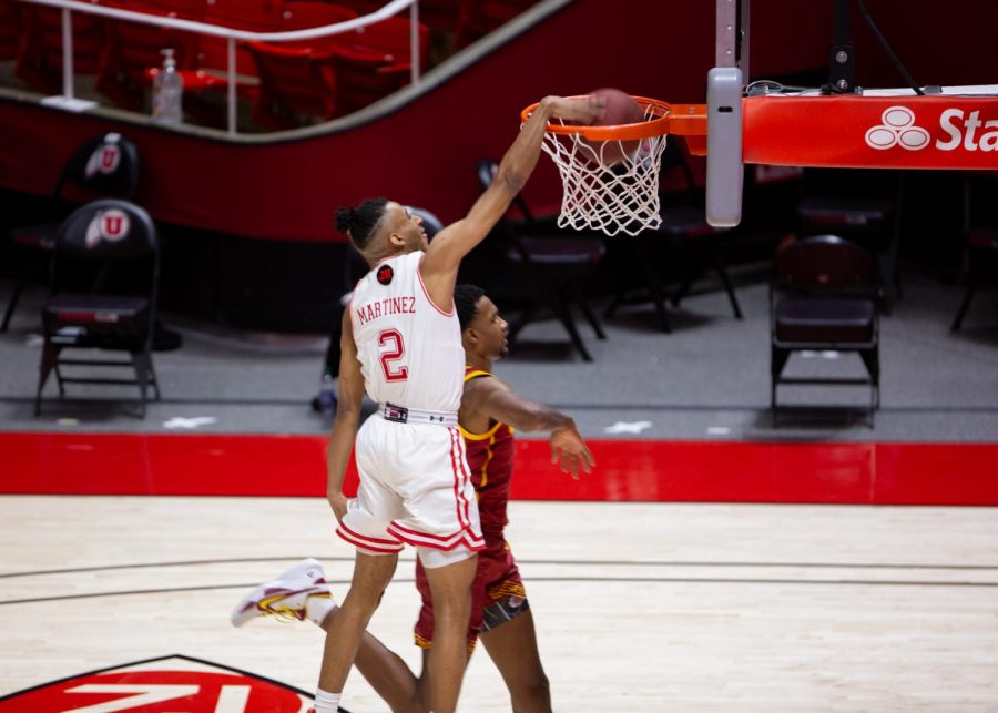 U of U freshman guard, Ian Martinez slams home the ball in the game vs the USC Trojans on Feb. 27th, 2021 at the Jon M. Huntsman Center on campus. (Photo by Jack Gambassi | The Daily Utah Chronicle)