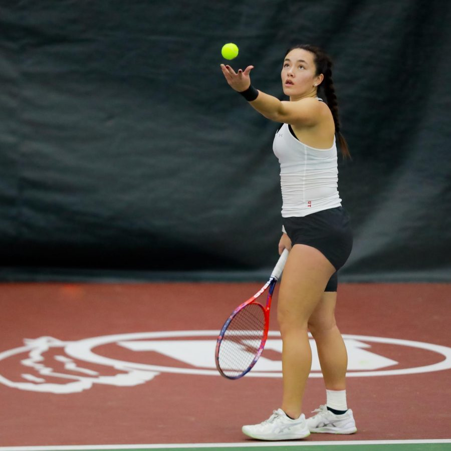 The Utah Women's Tennis player and University of Utah junior Anya Lamoreaux serves against the New Mexico State University in an NCAA dual Meet at the Jon M. Huntsman Tennis Center on 04 Feb. 2021 (Photo by Abu Asib | The Daily Utah Chronicle)
