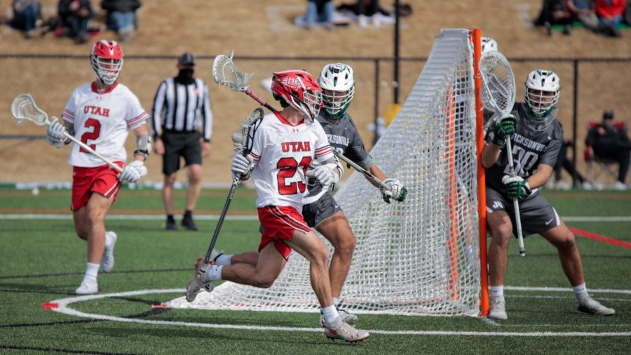University of Utah freshman and Utes Lacrosse team attacker Drew Tyler Bradbury looks to pass during an NCAA game vs. the Jacksonville Dolphines in Salt Lake City on March 6, 2021 (Photo by Abu Asib | The Daily Utah Chronicle)