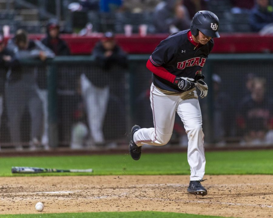 University of Utah sophomore infielder/outfielder Shea Kramer (15) walks to first during an NCAA Baseball game at the Smith's Ballpark in Salt Lake City, Utah on Thursday, April 11, 2019. (Photo by Kiffer Creveling | The Daily Utah Chronicle)