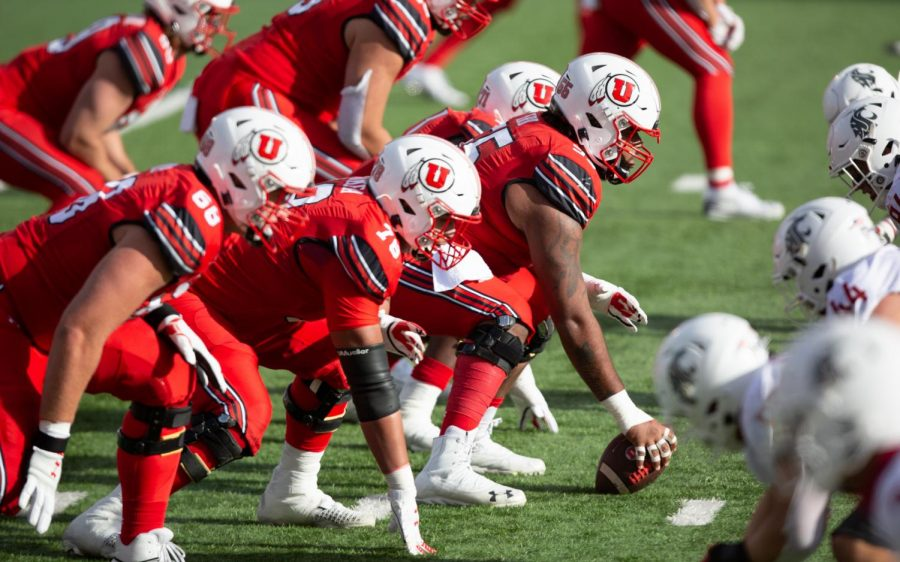 University of Utah Football offensive lineman, Nick Ford (#55) prepares to snap the ball in the Utes