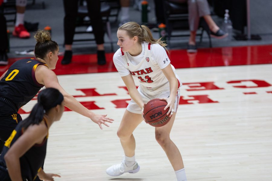 University of Utah women's basketball player, Brynna Maxwell (#11), holds the ball on offense in the game against Arizona State University in the Jon M. Huntsman center in Salt Lake City on Dec. 18, 2020. (Photo by Jack Gambassi | The Daily Utah Chronicle)