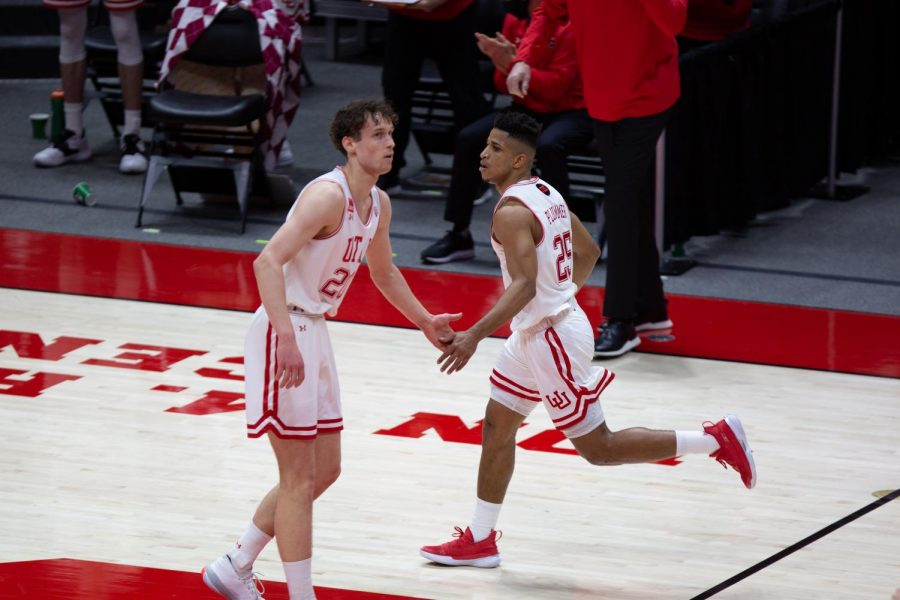 U of U sophomore forward, Mikael Jantunen (#20), high-fives teammate, Alfonso Plummer (#25), during the game vs. the USC Trojans on Feb. 27th, 2021 at the Jon M. Huntsman Center on campus. (Photo by Jack Gambassi | The Daily Utah Chronicle)
