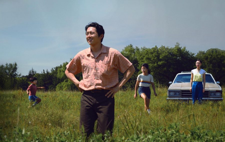 The Yi family looks out over their new land (Photo by David Bornfriend | Courtesy of A24)