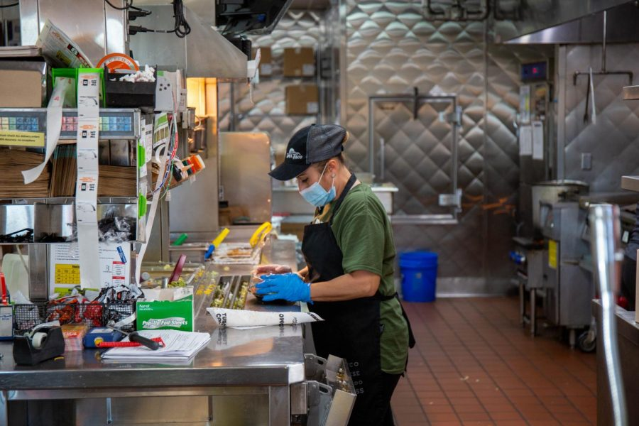 Silvia Ocampo prepares drive through orders at Del Taco on 800 E and 400 S in Salt Lake City on Nov. 14th 2020. (Photo by Gwen Christopherson | The Daily Utah Chronicle)