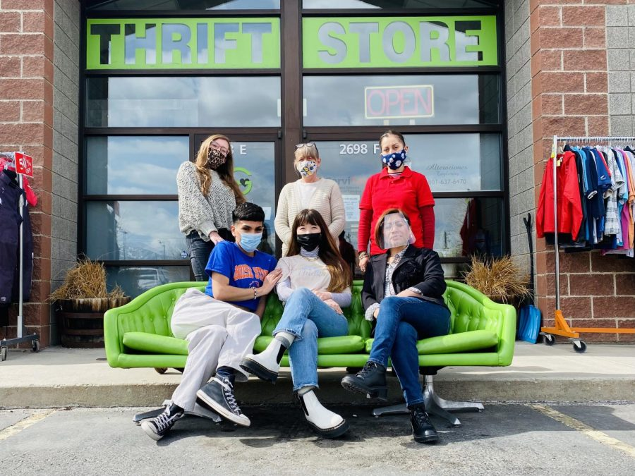 Green+World+Thrift+Market+owner+%26+director+Chelcia+Thomas+%28front+center%29+is+pictured+with+her+team+in+front+of+the+shop+in+West+Valley+City.+%28Courtesy+Green+World+Thrift+Market%29