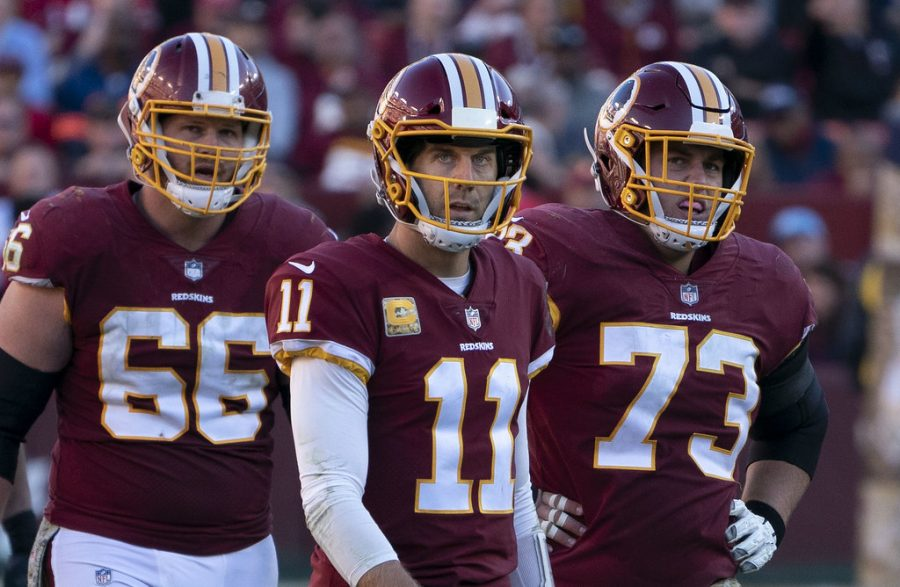 (From left to right) Tony Bergstrom, Alex Smith and Chase Roullier of the Washington Football Team in a game against the Atlanta Falcons on Nov. 4, 2018. (Courtesy Flickr)