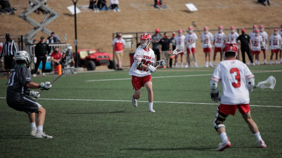 University of Utah freshman and Utes lacrosse team attacker Drew Wasserman looks to pass during an NCAA game vs. the Jacksonville Dolphins in Salt Lake City on March 6, 2021. (Photo by Abu Asib | Daily Utah Chronicle)
