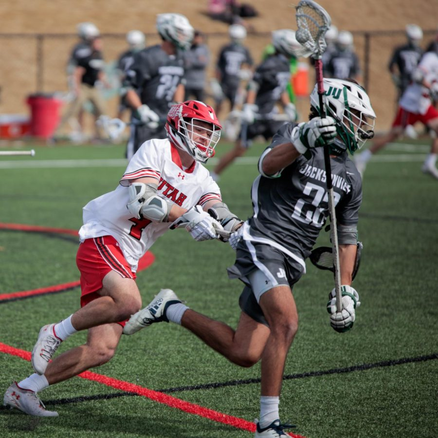 University of Utah freshman and Utes Lacrosse team attacker Jordan Hyde chases the ball during an NCAA game vs. the Jacksonville Dolphins in Salt Lake City on March 6, 2021. (Photo by Abu Asib | Daily Utah Chronicle)