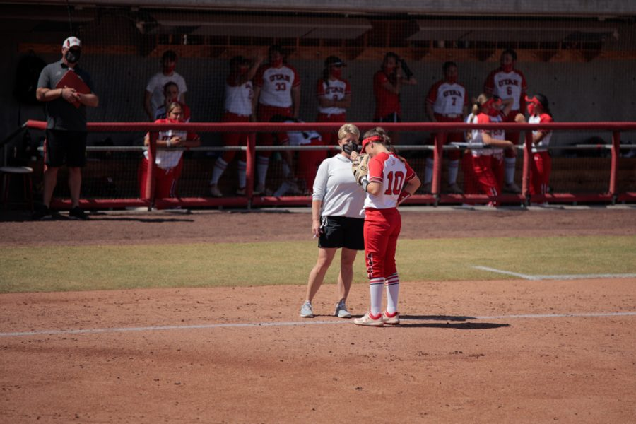 University+of+Utah+softball+team+head+coach++Amy+Hogue+tips+player+Julia+Noskin+%2810%29+during+an+NCAA+dual+meet+against+Stanford+University+at+the+Dumke+Family+Softball+Stadium+in+Salt+Lake+City+on+March+27%2C+2021+%28Photo+by+Abu+Asib+%7C+Daily+Utah+Chronicle%29