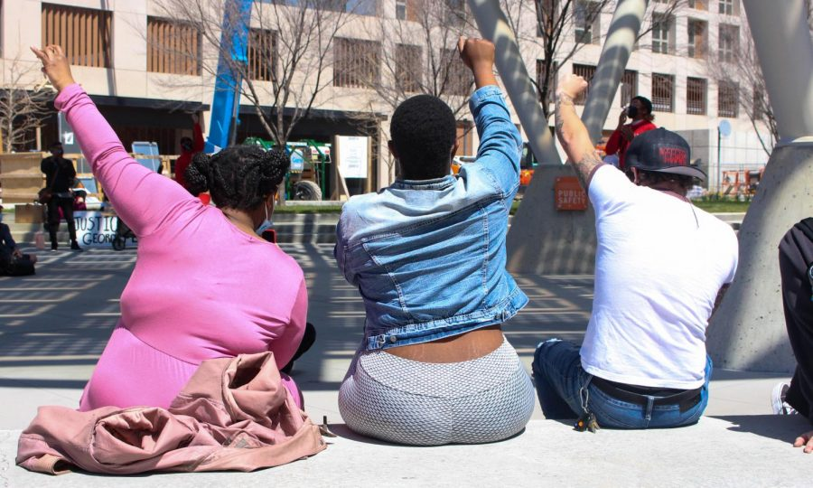 Demonstrators listen to speakers outside the Salt Lake City Police Department on April 17, 2021. (Photo by Gwen Christopherson | Daily Utah Chronicle)