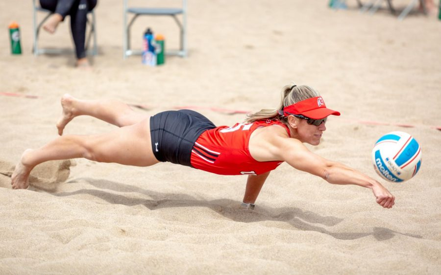 Olivia Teerlink dives for the ball in the volleyball match vs Salt Lake Community College on April 24, 2021 at the lassonde beach volleyball courts in Salt Lake City, UT. (Photo by Jack Gambassi | The Daily Utah Chronicle)