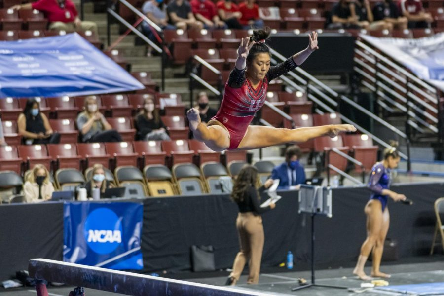 University of Utah junior Crystal Isa on beam at the NCAA Regionals Gymnastics meet at the Maverik Center in West Valley, Utah on Saturday, Apr. 03, 2021. (Photo by Kevin Cody | The Daily Utah Chronicle)