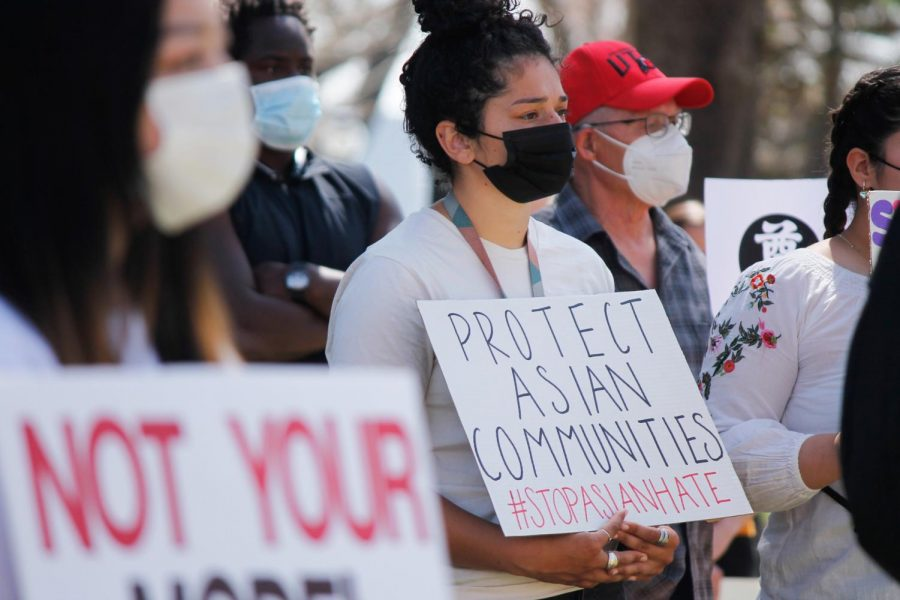 Delaney Rakuita holds sign at protest in support of Asian Americans at Washington Square Park in Salt Lake City,  on April 3, 2021. (Photo by Natalie Colby | Daily Utah Chronicle)