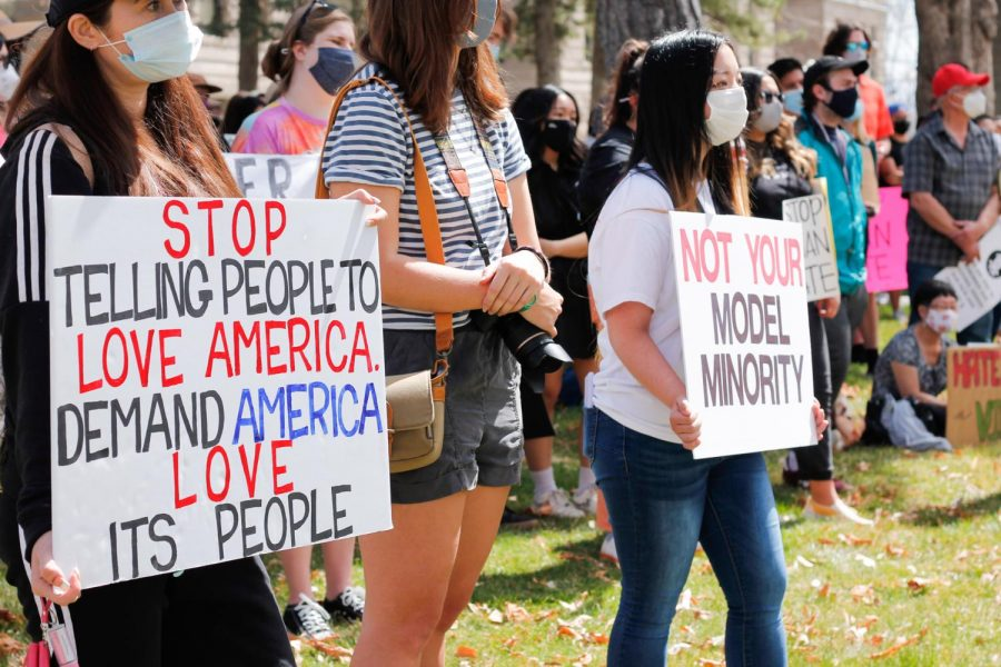 Protesters hold signs in support of Asian Americans at Washington Square Park in Salt Lake City on April 3, 2021. (Photo by Natalie Colby | Daily Utah Chronicle)