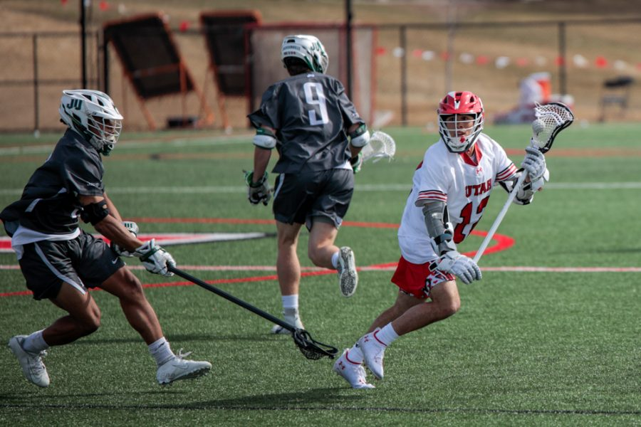 University of Utah sophomore and Utes lacrosse team midfielder Branden Wilson runs with the ball during an NCAA game vs. the Jacksonville Dolphins in Salt Lake City on March 6, 2021. (Photo by Abu Asib | Daily Utah Chronicle)