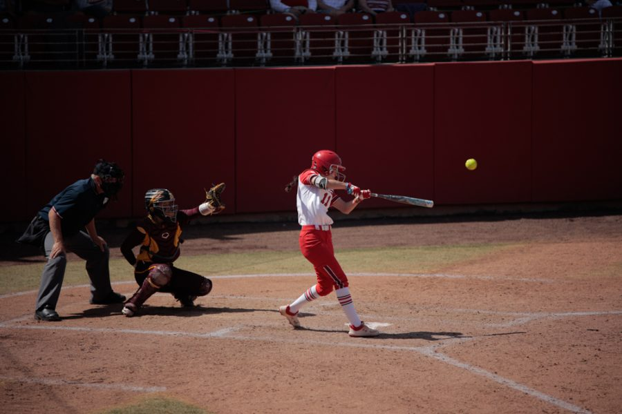 University of Utah Softball team player and junior Jordyn Gasper (No. 11) hits the ball during an NCAA dual meet against Arizona State University at the Dumke Family Softball Stadium in Salt Lake City on March 27, 2021. (Photo by Abu Asib | Daily Utah Chronicle)