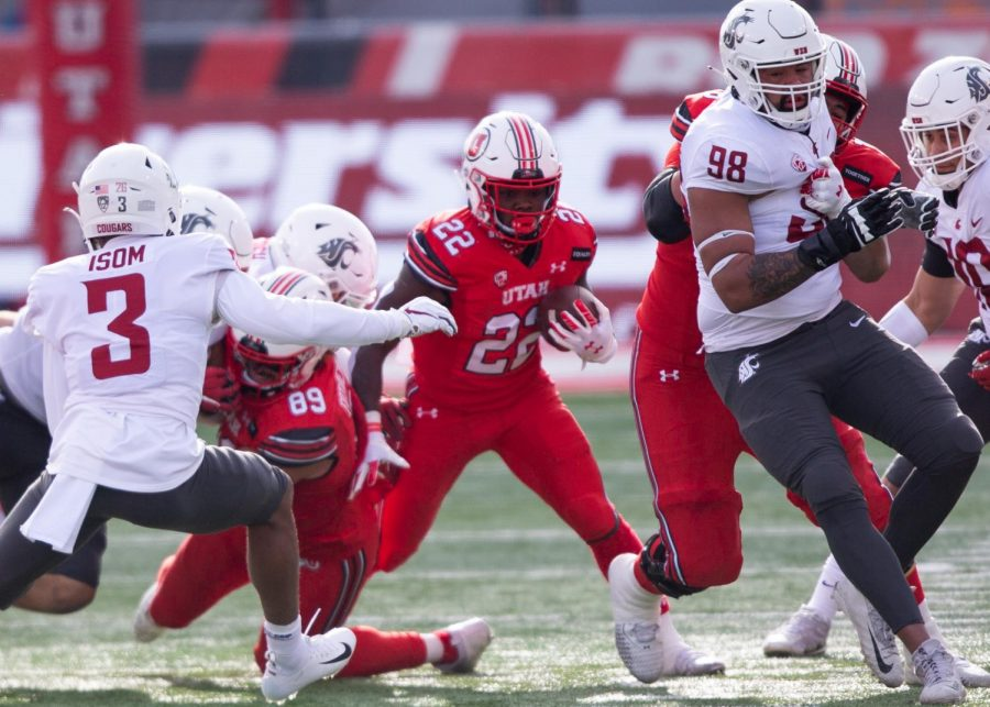 University of Utah football freshman running back Ty Jordan (No. 22) carries the ball down the field in the Utes