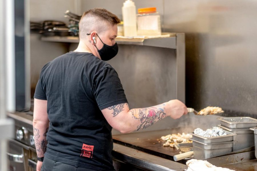 Holly Pound cooks chicken at Pulp Lifestyle Kitchen on May 22, 2021 in Salt Lake City. (Photo by Jack Gambassi | Daily Utah Chronicle)