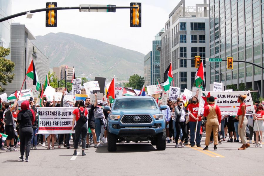 Protesters fill the streets waving Palestinian flags and Colombian Flags chanting as they march from the Wallace F. Federal building to the Gallivan Center in Salt Lake City on May 22, 2021. (Photo by Natalie Colby   Daily Utah Chronicle)