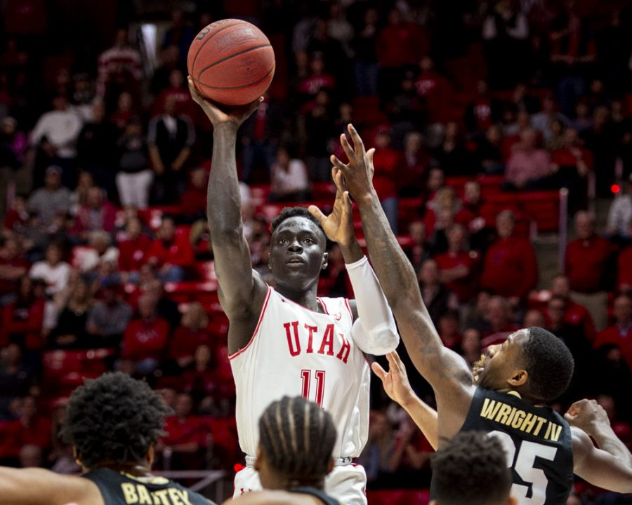 University of Utah sophomore guard Both Gach (11) takes a shot over University of Colorado junior guard McKinley Wright IV (25) to tie the game at the end of the second half during an NCAA Basketball game at the Jon M. Huntsman Center in Salt Lake City, Utah on Saturday, March 7, 2020. (Photo by Kiffer Creveling | The Daily Utah Chronicle)