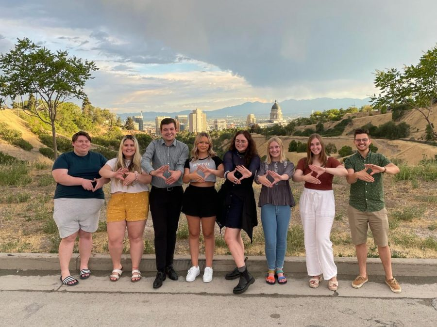 (From left to right) DECA members Dougie Wechsler, Victoria Wechsler, Tyler Jeppsen, Lauren Millenbach, Hailey Mishler, Kate Forth, Carly Anderson and Jared Collett. (Courtesy U DECA)