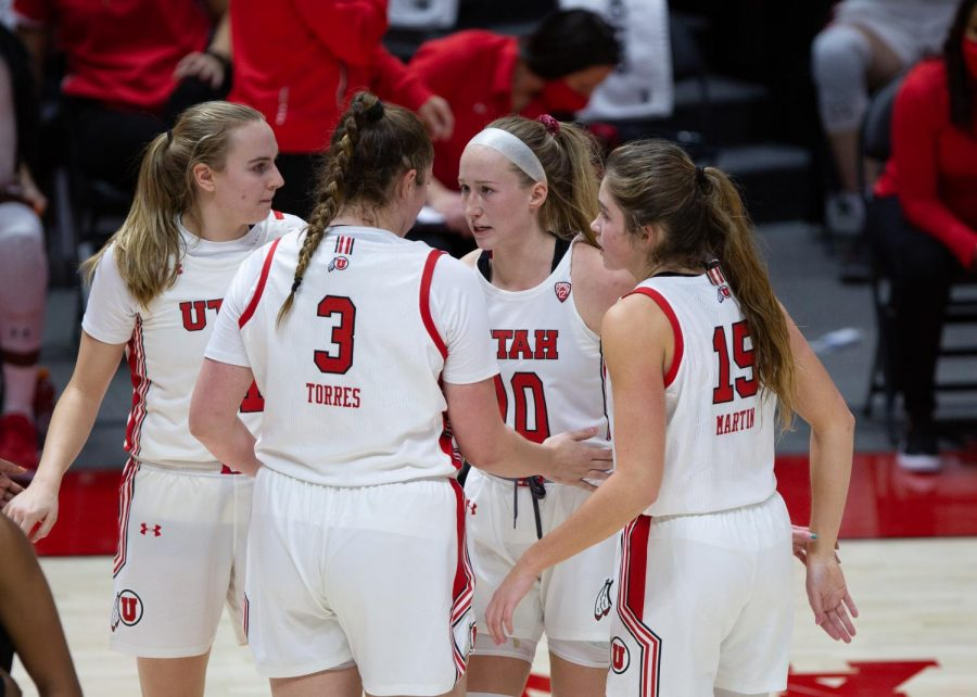 University of Utah women's basketball player, Dru Gylten (10), talks to teammates Andrea Torres (3), Kemery Martin (15), and Brynna Maxwell (11), in the game against Arizona State University in the Jon M. Huntsman center in Salt Lake City on Dec. 18, 2020. (Photo by Jack Gambassi | The Daily Utah Chronicle)