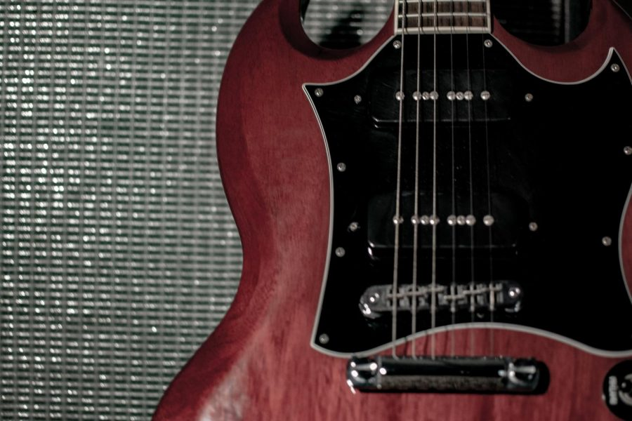 Gibson+SG+guitar+against+an+amplifier.+%28Courtesy+Eric+Openshaw%29