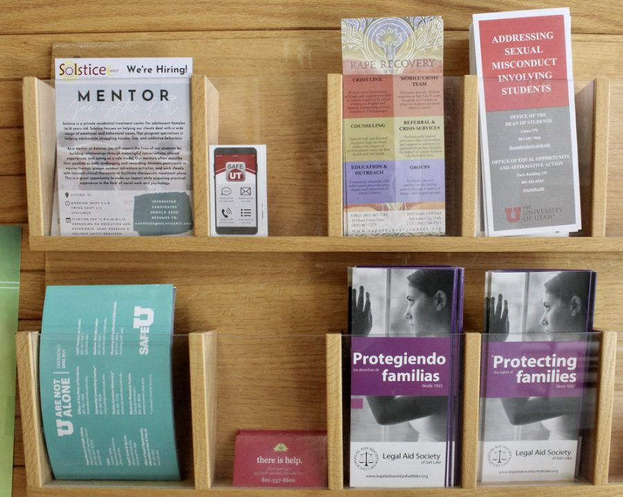 Inside the University of Utah Student Services Building a wall displays pamphlets with resources for sexual assault and mental health in Salt Lake City, on Tuesday, June 9, 2021. (Photo by Brooklyn Critchley | The Daily Utah Chronicle)