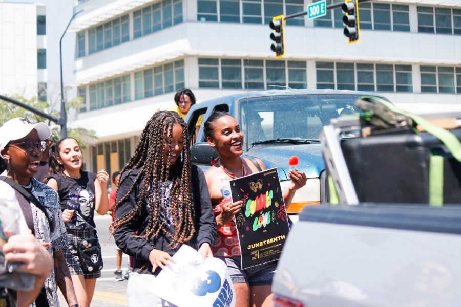 People+march+through+the+streets+of+downtown+Salt+Lake+City+celebrating+Juneteenth+on+June+19%2C+2021.+%28Photo+by+Natalie+Colby+%7C+The+Daily+Utah+Chronicle%29+