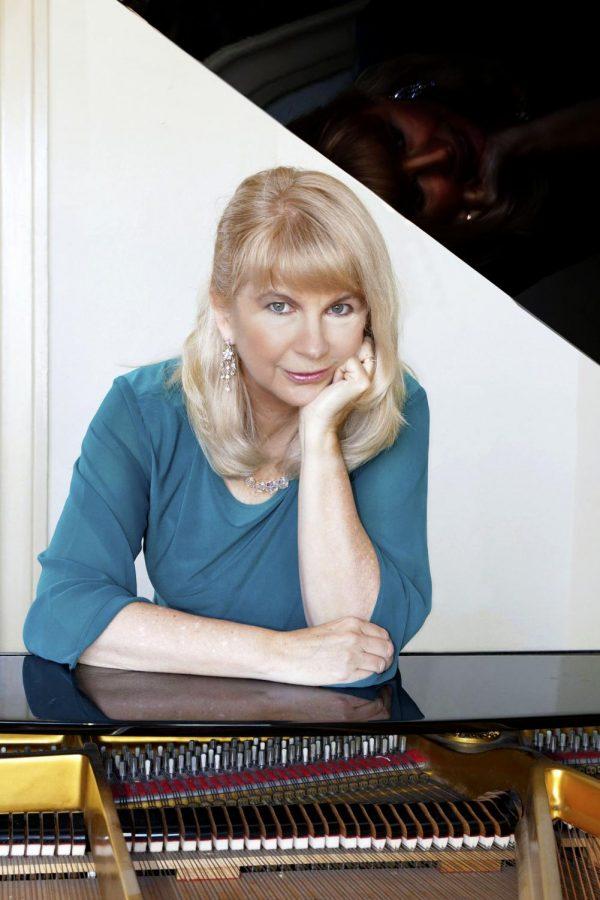 Headshot of Donna Stoering at piano