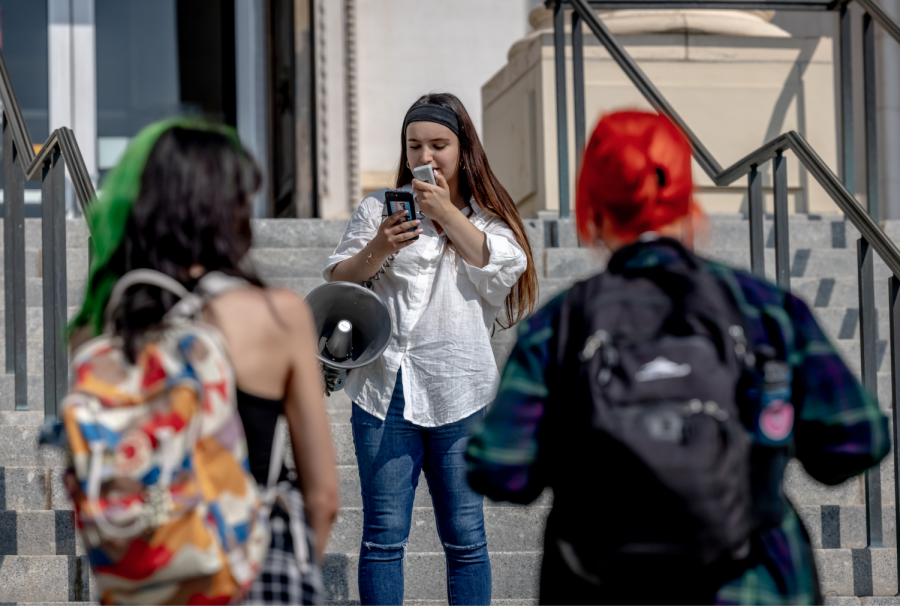 Student-organizer Ermiya Fanaeian speaks at a protest against the funding of campus police which she organized in front of the Park building on the University of Utah campus on Aug. 26, 2021. (Photo by Jack Gambassi | The Daily Utah Chronicle)