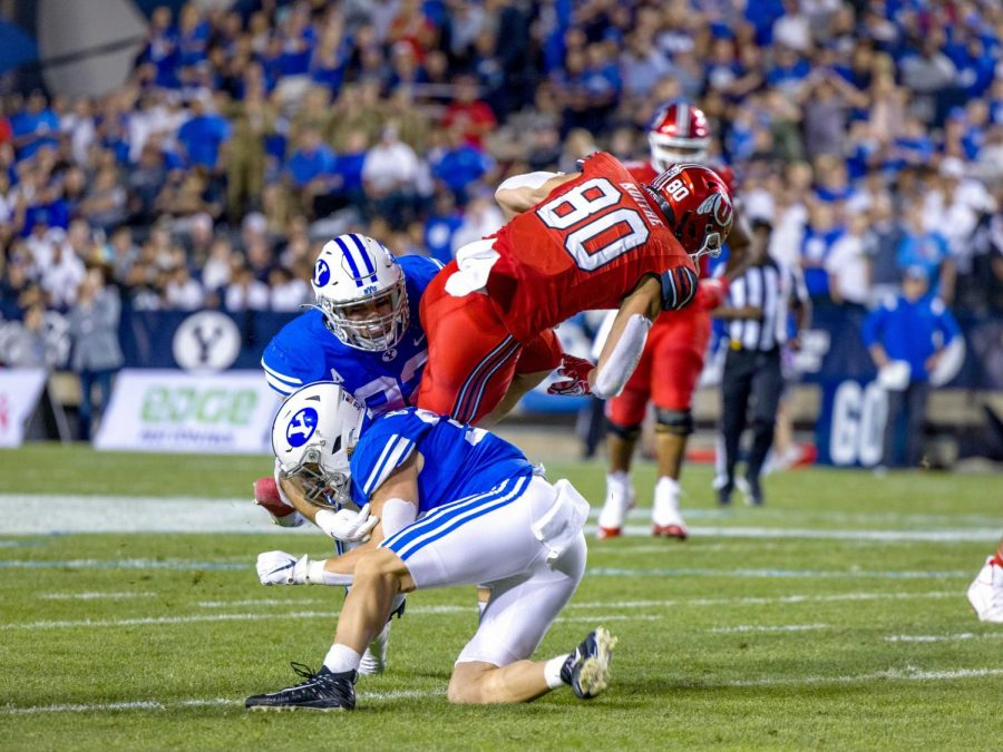 University of Utah's Brant Kuithe (#80) gets tackled during the game versus the BYU Cougars at LaVell Edwards Stadium in Provo, UT on Sept 11, 2021. (Photo by Jack Gambassi | The Daily Utah Chronicle)