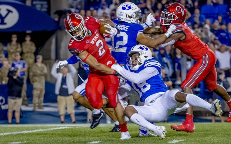 The+University+of+Utahs+Micah+Bernard+%28%232%29+pushes+for+the+endzone+during+their+game+versus+the+BYU+Cougars+at+LaVell+Edwards+Stadium+in+Provo%2C+UT+on+Sept.+11%2C+2021.+%28Photo+by+Jack+Gambassi+%7C+The+Daily+Utah+Chronicle%29