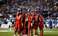 University of Utah's offense in the huddle during the game against the BYU cougars at LaVell Edwards Stadium in Provo, UT on Sept. 11, 2021. (Photo by Jack Gambassi | The Daily Utah Chronicle).