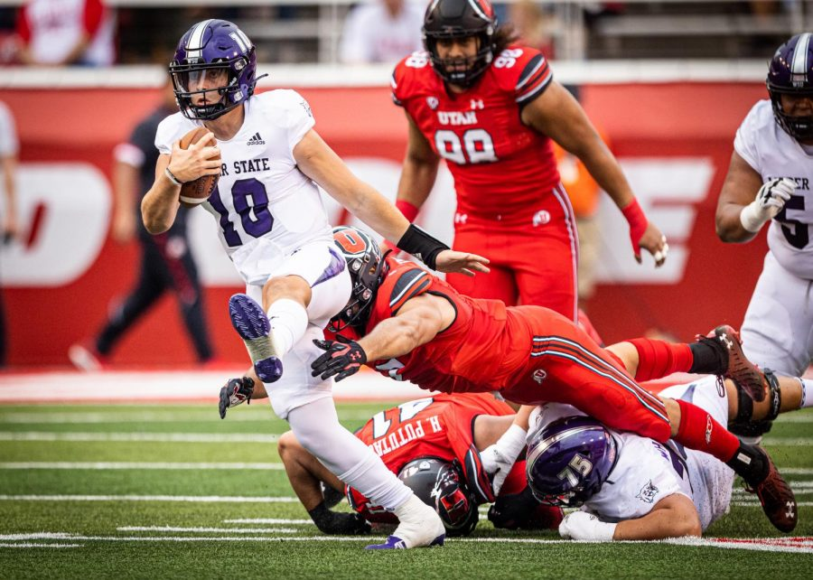 Utahs+defensive+end+Van+Fillinger+attempts+to+tackle+Weber+State+quarter+back+Bronson+Barron+in+Salt+Lake+City+on+Sept.+2%2C+2021.+%28Photo+by+Jonathan+Wang+%7C+The+Daily+Utah+Chronicle%29%0A