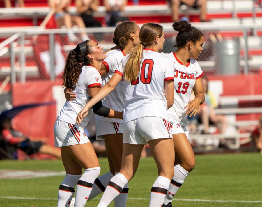 University of Utah womens soccer players celebrate a goal in the match vs. Dixie State at Utes field on the University of Utah campus on Sept. 12, 2021. (Photo by Xiangyao Axe Tang | The Daily Utah Chronicle)